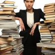 Girl and two large piles of books — Stock Photo