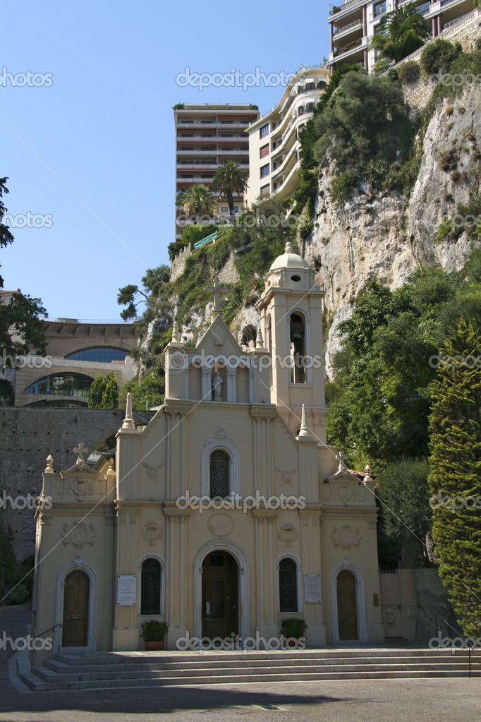 Old church in Monaco with modern buildings around  Stock Photo #2785723
