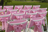 Chairs with pink bows — Stock Photo