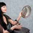 Beautiful woman   and silver wineglass — Stock Photo