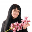 Beautiful woman  and an orchid — Stock Photo