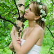 Young woman embraces   birch - Stock Photo