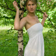 Young slender woman and birch - Stock Photo