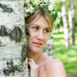 Young  woman and birch - Stock Photo