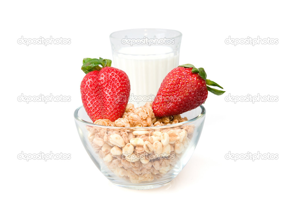Flakes, milk and a strawberry is isolated on a white background  Stock Photo #3181710