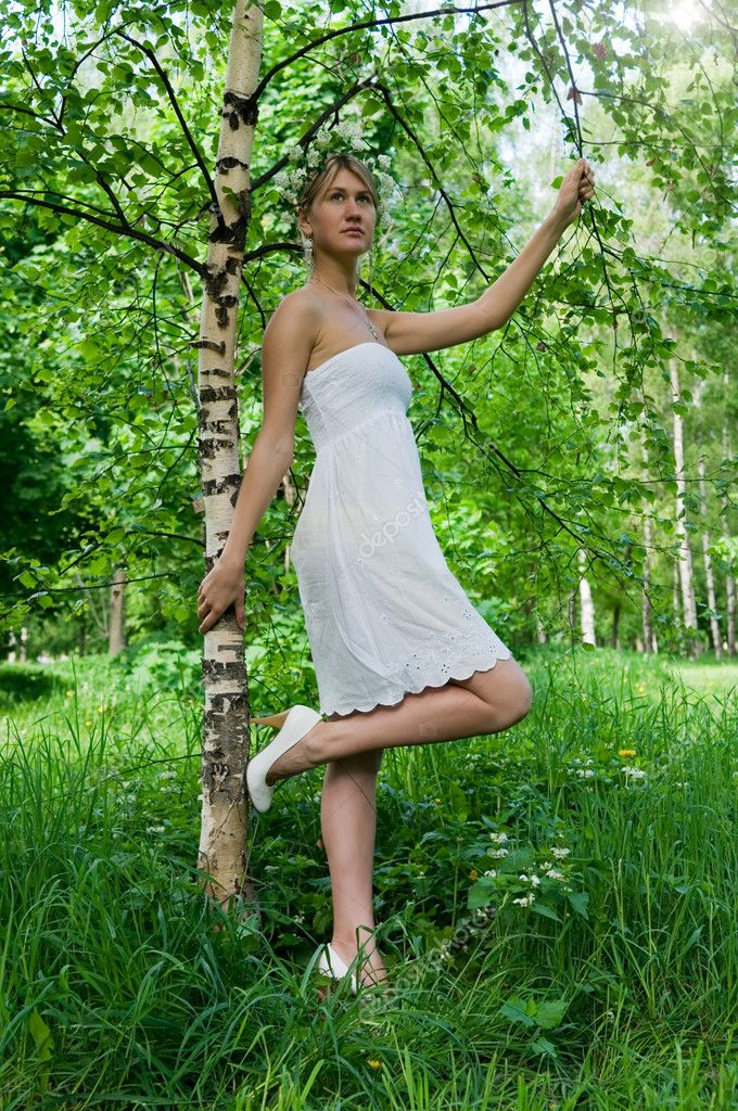 The young slender woman and thin birch — Stock Photo #3182090