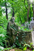 Sculpture of the woman on a cemetery — Stock Photo