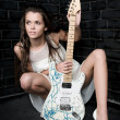 Woman with a white guitar — Stock Photo #3788049