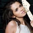 Woman with a white guitar — Stock Photo