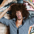 Young mwith curly hair — Stock Photo #3848764