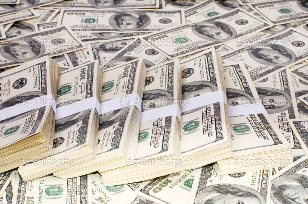 Background from dollar denominations and stack of money  Stock Photo #3861319