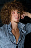 Man with a curly hair — Stock Photo