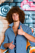 The young man with curly hair — Stock Photo