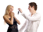 Man is presenting car keys for his girl — Stock Photo