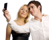 Young couple with mobile telephone — Stock Photo
