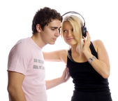 Young couple with headphones — Stock Photo