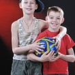 Two laughing boys with a ball — Stock Photo