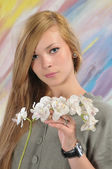 Portrait of beautiful girl with white orchid — Stock Photo