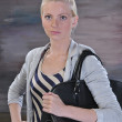 Young woman 20-25 years with road bag — Stock Photo