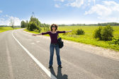 The young girl on automobile highway — Stock Photo