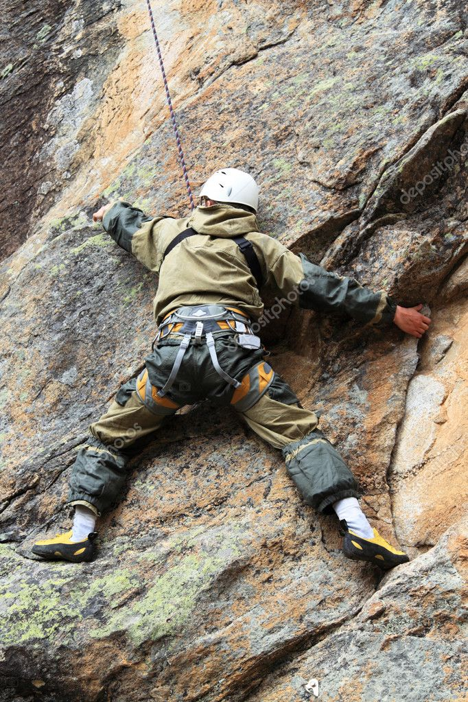 Rock-climber trains on a difficult granite rock  Stock Photo #3389017