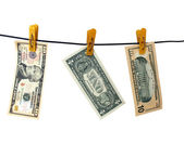 Dollars hang on clothes-peg — Stock Photo