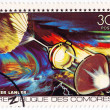COMORES  CIRCA 1980: stamp printed in Comores shows Apollo and Soyouz station in space mission, circa 1980 — Stock Photo