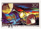 COMORES CIRCA 1980: stamp printed in Comores shows Apollo and Soyouz station in space mission, circa 1980 — Fotografia Stock