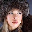 Woman in winter fur hat — Stock Photo #2700808