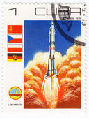 REPUBLIC OF CUBA CIRCA 1979: A vintage postal stamp printed in Cuba with a postmark dated 1904, depicting a rocket launch named Lanzamiento into space circa 1979 — 图库照片