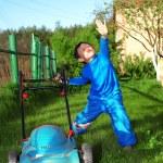 Funny lawnmore kid — Stock Photo
