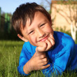 Little boy in green grass — Stock Photo