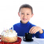 Boy with birthday cake — Stock Photo