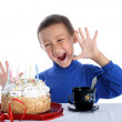 Boy with birthday cake isolated on white — Stock Photo