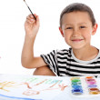 Stock Photo: Boy with paint isolated on white