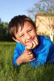 Little boy in green grass — Stock Photo