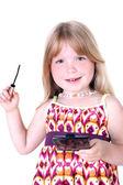 Small girl with liquid mascara — Stock Photo