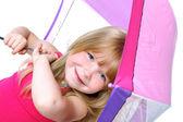 Small girl under umbrella — Stock Photo