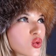 Woman in winter fur hat — Stock Photo #2728674