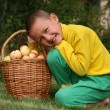 Boy posing outdoors with apples — Stock Photo