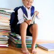 Schoolboy on the heap of books — Stock Photo #2732175