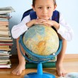 Schoolboy  with globe — Stock Photo