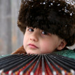Stock Photo: Boy with accordion under snowfall
