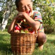 Boy posing outdoors with apples - Stock fotografie