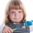 Royalty-Free Stock Photo: Little girl with brushes for teeth