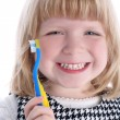 Little girl with brushes for teeth - Stock Photo
