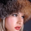 Lovely young woman in winter fur hat — Stock Photo