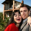 Couple beside their new house — Stock Photo