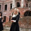 Stock Photo: Jealousy -girls and mbeside old house