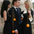Stock Photo: Jealousy - two girl with oranges and man